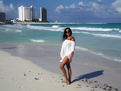 Me wearing my ivory modal poncho in front of our condo in Cancun, check my other pin for RENTAL rates and link to website. I make this luxurious beach poncho in various colours, priced only 55$! Made in Canada . http://www.uchimama.net