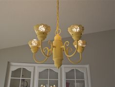 this is one ladies finished chandelier makeover...I couldn't believe the before...she flipped the lights the other way and used craft paint and doilies painted gold!
