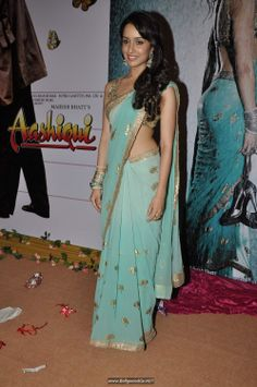 I just love this saree, and especially the jhumka's she's wearing! (Credit to Owner)