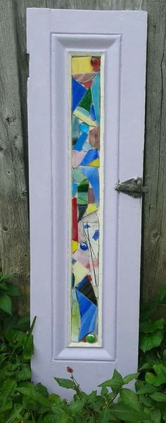 stained glass mosaic on an old shutter