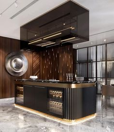 Chic kitchen island A special feature of this kitchen is anodized aluminum facades and a hood over t Kitchen Room Design, Luxury Kitchen Design, Home Decor Kitchen, Modern House Design, Kitchen Interior, Kitchen Modern, Fancy Kitchens, Luxury Kitchens, Home Kitchens