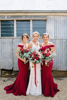 Ruby red off the shoulder bridesmaid dresses for elegant vintage wedding   Lucinda May Photography