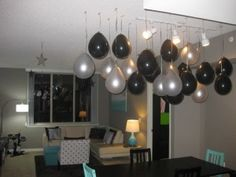 "put pennies or marbles in the balloons to make them hang down for this ""balloon chandelier"""