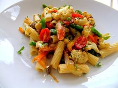 Roasted Veggie Pasta for a Crowd - Proud Italian Cook-I used farfalle, red bell, yellow squash, zucchini, yellow onion, cherry toms & garlic