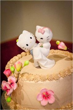 wedding cake with swiss dots and Hello Kitty cake toppers from