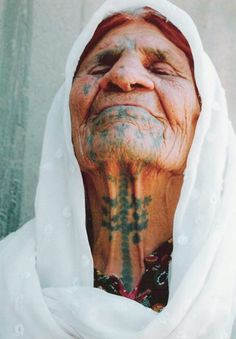 Old Algerian lady with facial/neck tattoos. (Many Algerian women tattooed their faces during the late 50's early 60's (during the war of Independence)to appear unattractive, and thus avoid rape by the savage French soldiers)  Interesting.