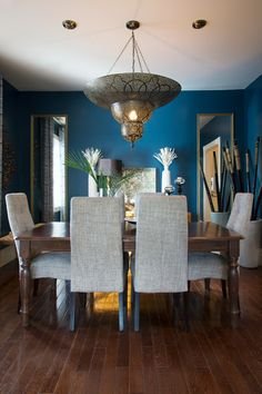The dark blue wall paint in the dining room changes from peacock in the daytime to indigo at night. Sherwin-Williams Rainstorm