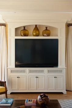 living room painted paneled television cabinet with segmental arch living media architectural detail design detail american