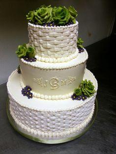 Basket weave buttercream wedding cake with gumpaste flowers.