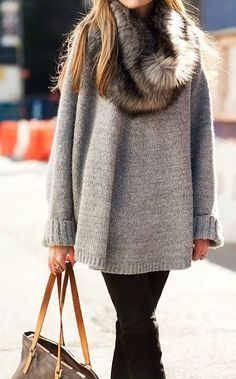 Try pairing a grey oversized sweater with black jeans for a casual coffee run.  Shop this look for $90:  http://lookastic.com/women/looks/black-jeans-brown-tote-bag-grey-oversized-sweater-brown-scarf/7012  — Black Jeans  — Brown Leather Tote Bag  — Grey Oversized Sweater  — Brown Fur Scarf