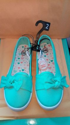 4c3d15fa30e3 Has permanent bows on top of each shoe. Mint green with white rubber soles.