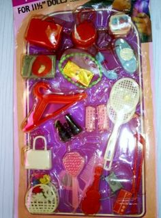 Barbie accessories, I think we had this set. I definitely had those tennis rackets and the basket of flowers.