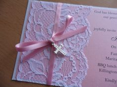 Girls Christening invitation with pink card and white lace.