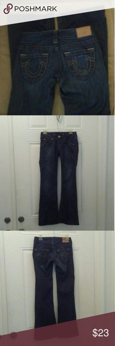 Hemmed True Religion jeans horseshoes on pockets Gently used. Size 25. Some fading present (see pics). Back pocket fading where cell phone was kept. PLEASE READ: Hemmed. Current inseam 31''. If you remove the hem they will be 2'' longer (33''). Feel free to make an offer. I describe all of my listings and provide clear photos. If you have any questions please feel free to ask. Comes from a smoke free home. I video record packing all items for quality assurance. I LOVE OFFERS! True Religion…