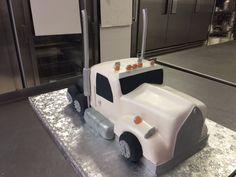 3-D, 18-wheeler truck all white birthday cake using al fondant.