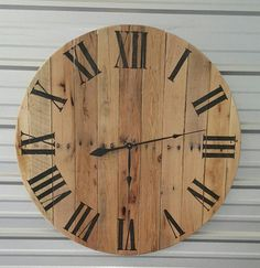 Introducing our 36 Reclaimed wood wall clock with Roman numerals and natural finish! Add this timeless piece of decor to your home and watch the heads turn! It will fit into any decor setting and really dress up your home.