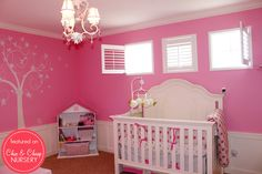 Love the paint color and the tree mural,  Ah, the whole room is just adorable.