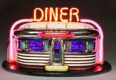 """Owens' Walter E. Terhune Art Gallery opens the 2011-12 Arts Exhibition Season with a """"Diners"""" exhibit featuring such works as Jerry Berta's """"Neon Diner"""" ceramic and neon sculpture."""