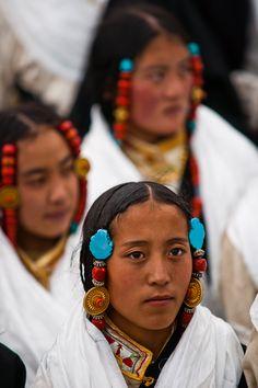 Tibetan women wearing traditional costumes  by Michael Yamashita