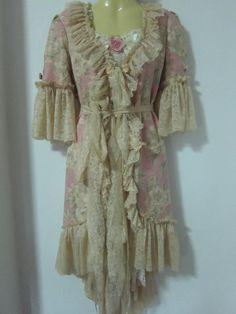 vintage dress turned jacket....soft hues of pink green and creme...
