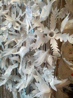 Plastic bottle snowflakes on Anthropologie display