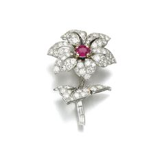 Ruby and diamond brooch, Cartier, 1950s Designed as a flower, set with an oval ruby, brilliant-cut and baguette diamonds, signed Cartier, numbered, French assay and partial maker's marks.