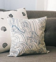A comfy and colorful accent for your living space, this canvas pillow cover is printed with a hand-illustrated. Cotton and linen blend canvas is screenprinted with a repeating pattern of cresting waves in dark blue ink. Just pop in a pillow form to add this accent to your sofa, armchair or bedroom.