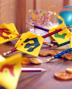Pencil and Paper Dreidels Craft DIY  Great for kids school and recycle  This is an easy way to make the traditional spinning top out of everyday materials.