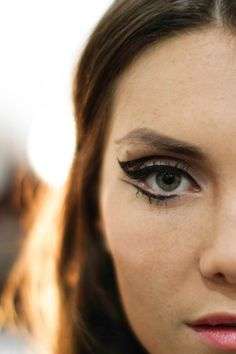Graphic winged liner.
