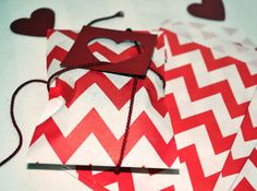 Favor bags with heart cut outs- Valentine's Day Prep #sweettreats #valentinesfavors