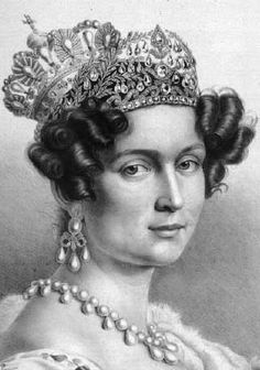 Queen Therese of Bavaria wearing coronation crown with diamond tiara before it.  Complicated design of 2 'wave' bands meeting in the centre where 2 two large diamonds are arranged in ascending order.  Above, laurel branches from a wreath with pendant, drop shaped diamonds.  Broken up in 1832