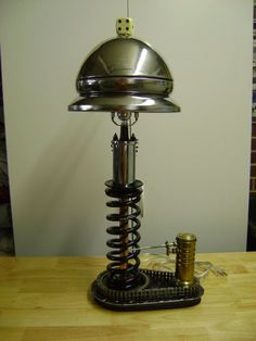 automotive inspired table lamp. new lamp made from old parts.