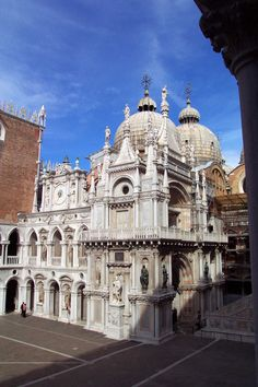 Foscari Arch - Doge Francesco Foscari  -- Doges' Palace, Venice, Italy - This is a three-quarter view of the Foscari Arch. Doge Francesco Foscari reigned for 34 years, until 1457. After his unscrupulous son was banished from Venice twice, Doge Foscari was stripped of his power. The doge, brokenhearted, lost all interest in the affairs of state. Yet succeeding doges kept up the building program that both glorified Foscari and the office of the doge itself. Foscari's misfortunes became the...t