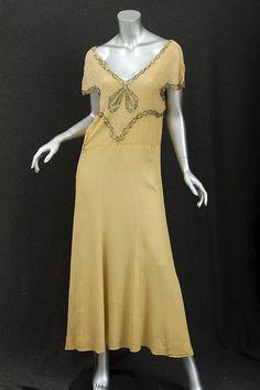 ~Beaded chiffon and crepe evening dress, 1930s~  This gorgeous dress with its plunging neckline and glittering rhinestones personifies 1930s H...