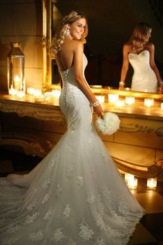 Be a legend in Lace in this stylish and elegant fit and flare wedding gown. The craftsmanship and beadwork on this strapless full Lace dress is like no other.