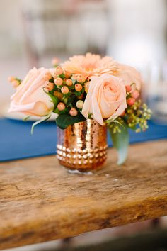 Love this peach + copper floral centerpiece for a spring or summer wedding.