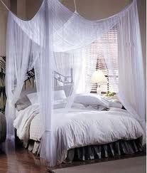 A very romantic bed with draping canopy sheers