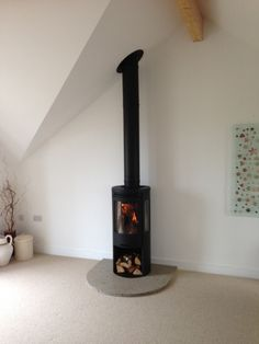 This Contura 556 sits nicely on a homemade hearth made from a mixture of non combustible materials, including glass. #contura #stove #fire #wood #burner #homemade #design #hearth #non #combustible #glass #curved #d #shaped #modern #contemporary #kernowfires #wadebridge #redruth #cornwall