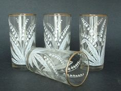 "Vintage Lily of the Valley Glass Tumblers Set of 4. $23.00, via Etsy. The glasses measure 5"" high and 2-1/2"" across the top."
