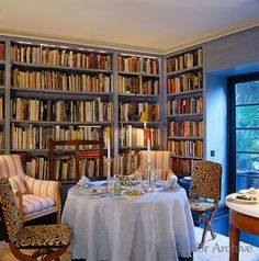 decordesignreview:  pale blue skirted table, leopard chairs and stripes in this cosy book-filling dining - library ~ John Stefanidis design