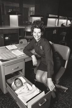 Old Photography | A Los Angeles police officer looks after an abandoned baby in her desk drawer