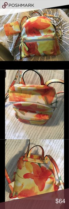 GUESS Floral backpack New for Spring/Summer  Bright floral backpack/purse and the colors are popping! I also have a matching wallet in my closet if you would like to bundle! Guess Bags Backpacks