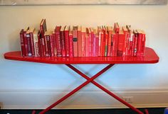 Ironing board as a book shelf. I bought my cool ironing board - now I just need to find a cool place to put it.