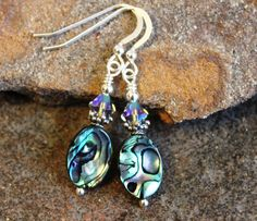 Paua shell earrings. I love the colors in paua shell...blues, greens, some pink. Perfect for summer! Also included are sterling silver bali bead caps, Swarovski elements, sterling silver beads & findings.  @)--;-----  #30456