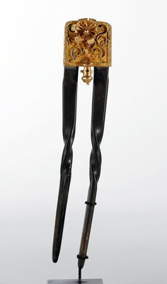 Ghana | Double hairpin from the Akan people; domestic goat horn and gold | 1'000$ ~ sold (May '11)