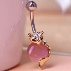 Cat Eye Piercing (Belly Button Ring) Fine or Fashion: Fashion Item Type: Body Jewelry Style: Trendy Body Jewelry Type: Navel & Bell Button Rings Material: Rhinestone Metals Type: Stainless Steel Shape