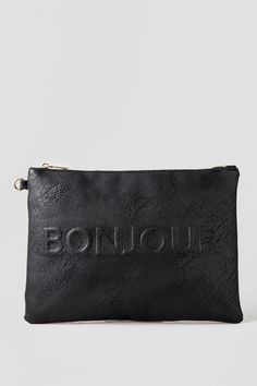 """Don a taste of Paris with the Bonjour & Au Revoir Bag! Bonjour & Au Revoir translates into Hello & Goodbye in French. The black & white bagis sure to gather some attention. The multi-purpose bag can be used for just about anything, from an overnight toiletries bag to a night out with the girls clutch.<br /> <br /> - 12.5L x 9W x 1D""""<br /> - Removable wrist strap<br /> - Imported<br />"""