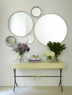 How cool is this? I think a colored wall would show the arrangement better, but I really like the contemporary look a few different sized circled mirrors create -easy to do!