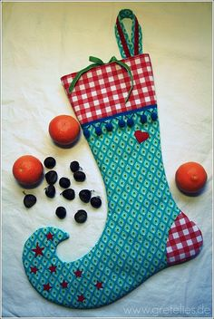 Will Santa put presents in cute sock like this ?  found here: http://gretelies.blogspot.com/2010/11/erster-weihnachtspost-oder-ich-bin.html