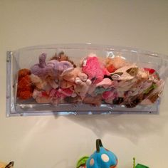 Super cheap and easy stuff toy storage made from window well covers :).